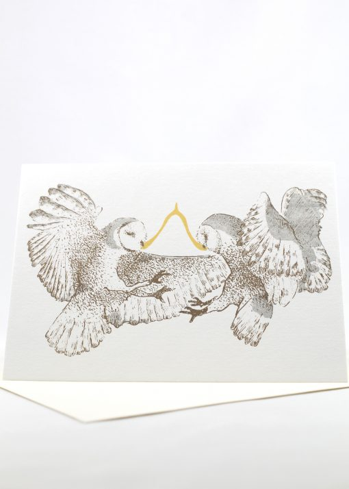 Owls pulling on a wishbone