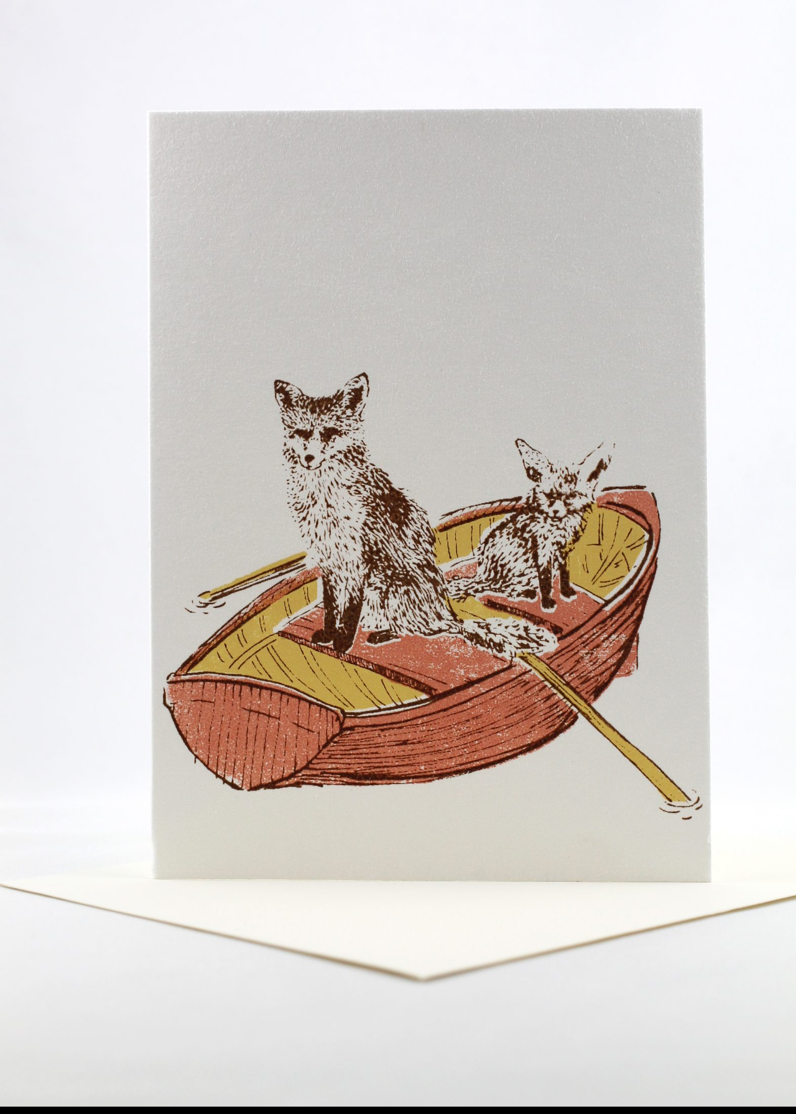 Blank card, foxes in a row boat